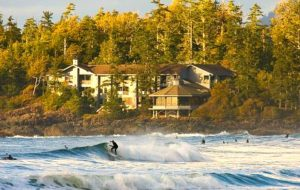 Wickaninnish Inn with surfers catching waves