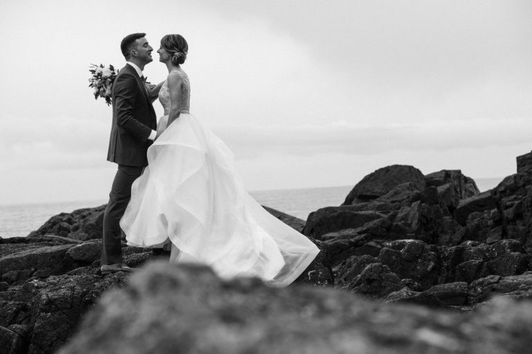 Tofino Wedding Photo Co. photo of a Bride & Groom on rocky shoreline.