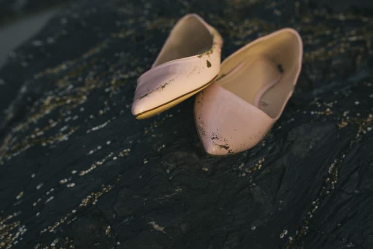 Tofino Wedding Photo Co. of wedding shoes on rocky coastline