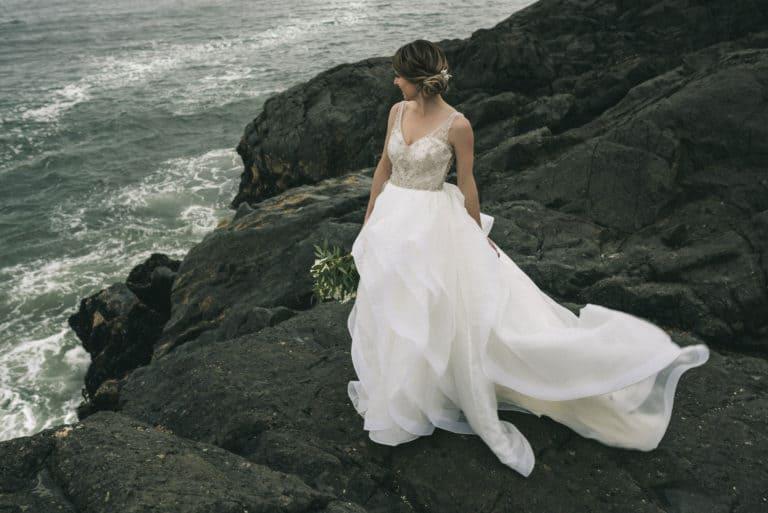Tofino Wedding Photo Co. with Tofino Wedding Photo Co. with Bride on rocky shoreline.