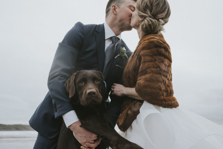 Tofino Wedding Photo Co. with wedding couple kissing handsome dog is with them