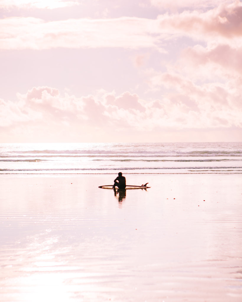 Surfer in pink sky